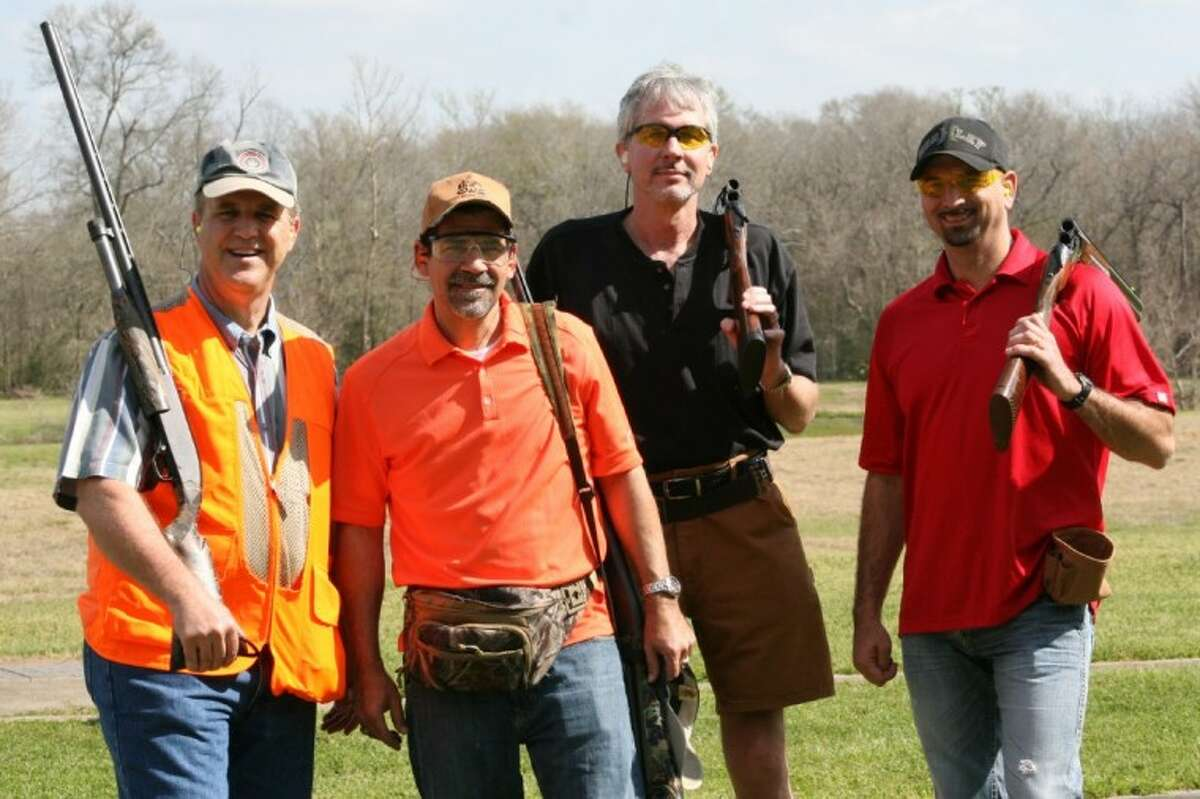 Last year's team of (left to right) Charles Kreger, Paul Virgadamo, Wallace Dodd and Steve Williams are all smiles as they finish up a round of skeet at the Conroe Noon Lions Club Annual Skeet Shoot, which is Saturday at Creekwood Shooting Range.