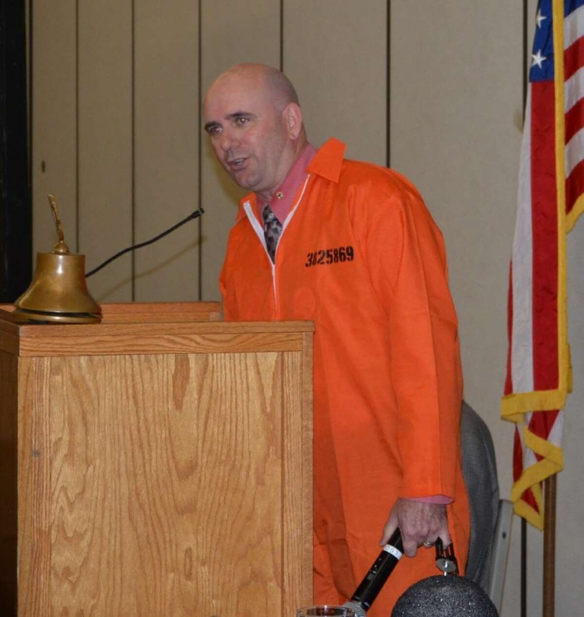 """Conroe Noon Lions Club President and Conroe Chief of Police Philip Dupuis had to """"pay up"""" after the club met his challenge of getting 10 new members in one month, which was to go to jail. Here is the chief in his jailhouse orange."""