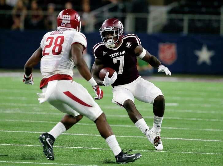 Arkansas defensive back Josh Liddell (28) gives chase as Texas A&M running back Keith Ford (7) runs the ball in the first half of an NCAA college football game, Saturday, Sept. 24, 2016, in Arlington, Texas. (AP Photo/Tony Gutierrez)
