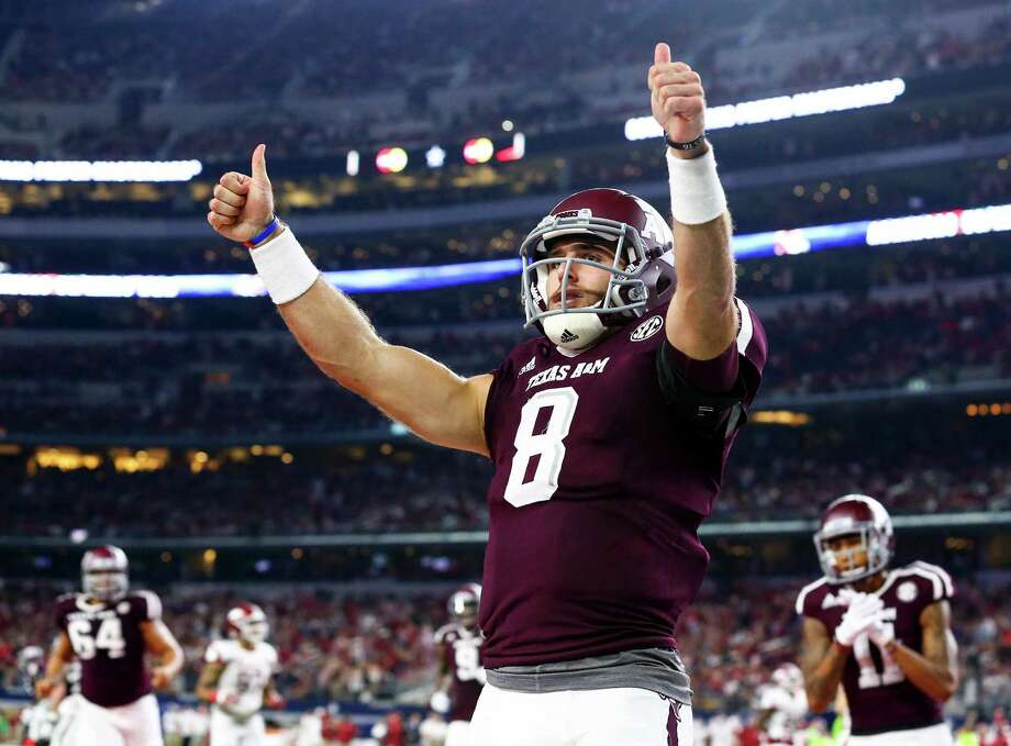 Texas A&M quarterback Trevor Knight (8) celebrates a touchdown against the Arkansas Razorbacks in the second quarter Saturday night at AT&T Stadium in Arlington.  The Aggies remain undefeated at 4-0. Photo: Richard W. Rodriguez, MBR / Fort Worth Star-Telegram