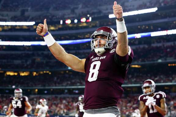 Texas A&M quarterback Trevor Knight (8) celebrates a touchdown against the Arkansas Razorbacks in the second quarter Saturday night at AT&T Stadium in Arlington.  The Aggies remain undefeated at 4-0.