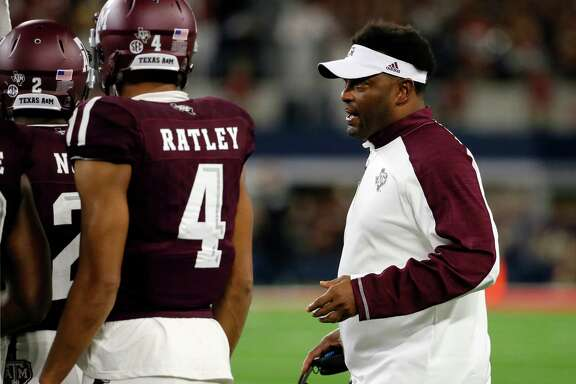 Texas A&M coach Kevin Sumlin talks to players on the sideline late in the second half of an NCAA college football game against Arkansas on Saturday, Sept. 24, 2016, in Arlington, Texas. Texas A&M won 45-24. (AP Photo/Tony Gutierrez)