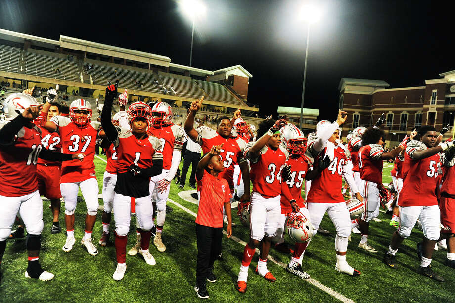 Members of the Cy Lakes football team celebrate after breaking the program record for wins in a season by defeating Cy Falls on Saturday night, Sept. 24, 2016. Photo: Tony Gaines