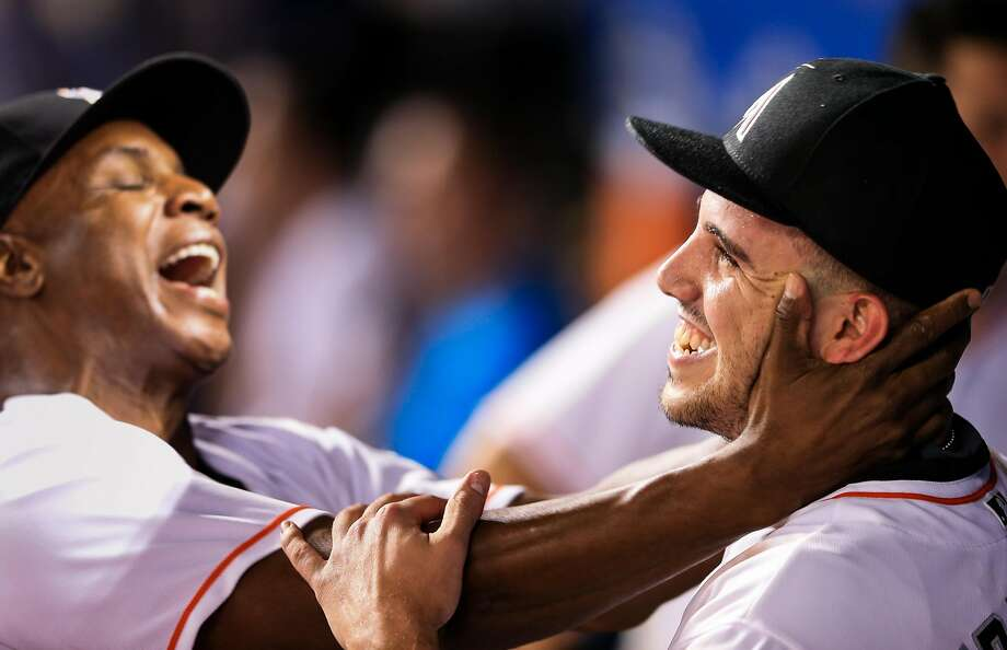 MIAMI, FL - SEPTEMBER 20: Jose Fernandez #16 of the Miami Marlins celebrates in the dugout with hitting coach Barry Bonds during the game against the Washington Nationals at Marlins Park on September 20, 2016 in Miami, Florida.  Photo: Rob Foldy, Getty Images