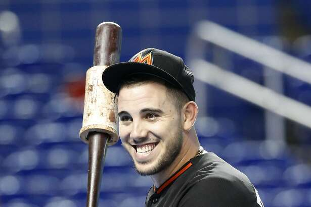 Miami Marlins' Jose Fernandez smiles as he takes batting practice before the start of a baseball game against the Chicago White Sox, Saturday, Aug. 13, 2016, in Miami. (AP Photo/Wilfredo Lee)