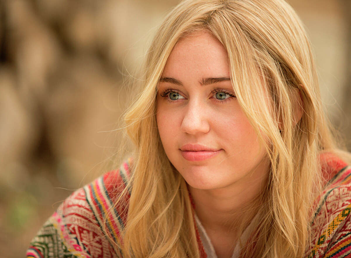 Miley Cyrus as a runaway radical from a well-to-do family.