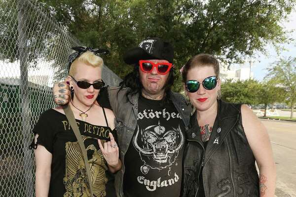 Hard rock and metal fans pose for a photo at Houston Open Air Festival at the NRG Park complex Saturday, Sept. 24, 2016, in Houston.