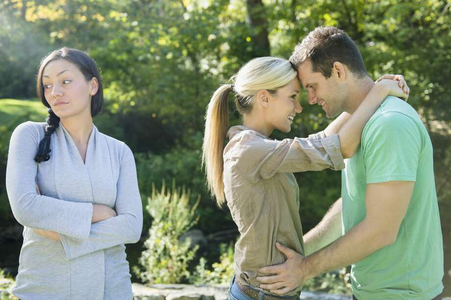 A woman thinks her sister is making a big mistake by marring a man she doesn't approve of. Photo: Jamie Grill/Getty Images/Tetra Images RF