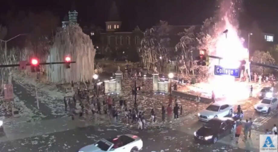Surveillance video showed someone set fire to one of the oak trees at Auburn's Toomer's Corner after Saturday night's win over LSU Photo: Auburn Police Department