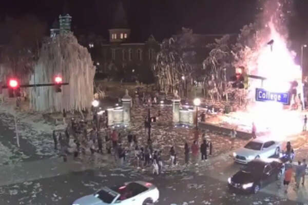 Surveillance video showed someone set fire to one of the oak trees at Auburn's Toomer's Corner after Saturday night's win over LSU