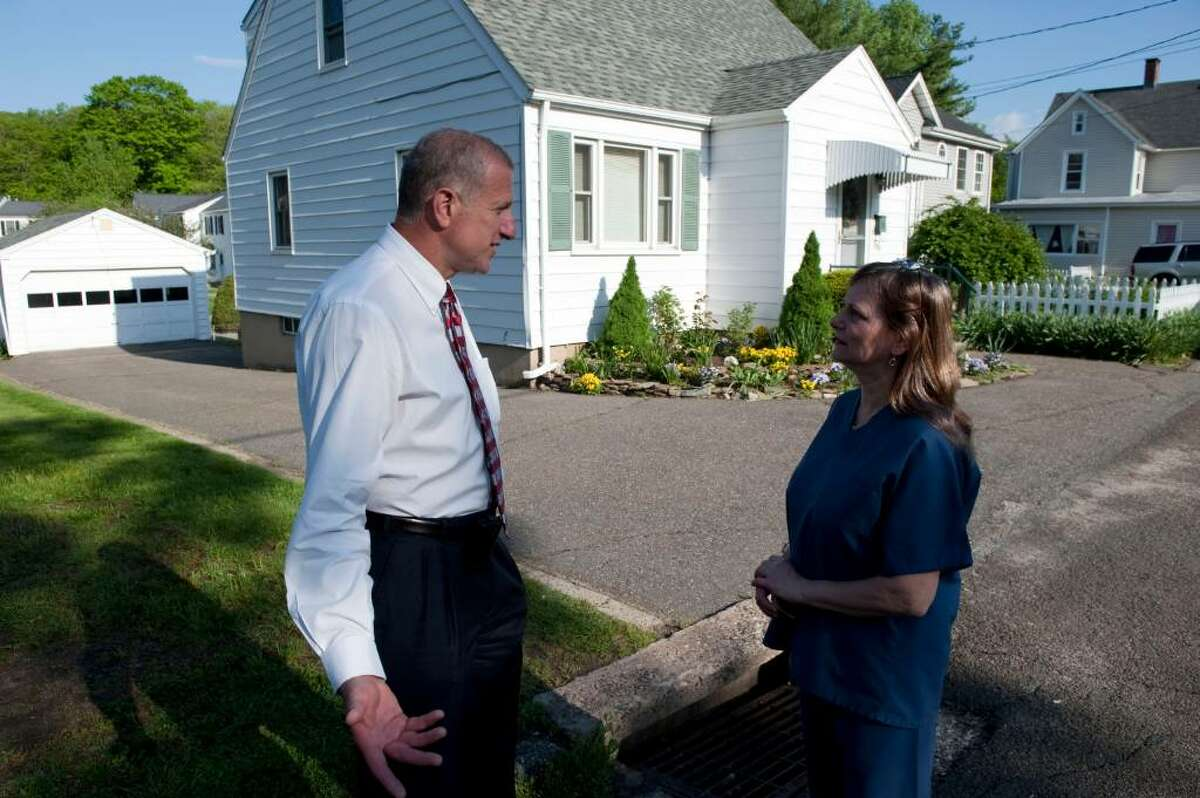 Shelton Mayor Mark Lauretti talks with Debbie Bussolari about Faisal Shahzad who was a neighbor lived in Shelton, Conn. Tuesday May 4, 2010. Faisal Shahzad was arrested Monday at JFK airport in connection to the failed Times Square car bomb he is alleged to have purchased the Nissan SUV. (AP Photo/Douglas Healey).