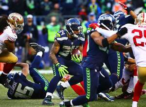 Seattle's Thomas Rawls (34) weaves through the defense  in the fourth quarter of the Seahawks game against the 49ers, Sunday, Nov. 22, 2015. Rawls rushed for 209-yards during the game to break a Seahawks rookie record. (Genna Martin, seattlepi.com)