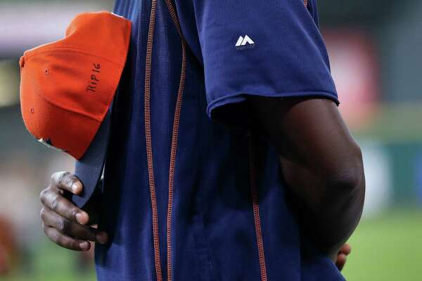 "Houston Astros pitcher David Paulino with ""RIP 16"" written on his baseball cap in honor of Marlin's Jose Fernandez, who was killed in a boating accident before eat start of an MLB game at Minute Maid Park, Sunday, Sept. 25, 2016 in Houston."