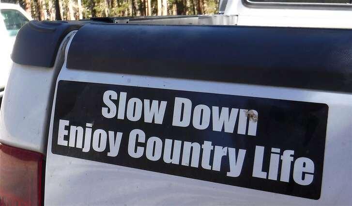 In Yosemite National Park, a bumper sticker urges drivers to slow down. A new strategy in Yosemite Valley converts two-lane one-way roads, where some speeding drivers weaved in and out of traffic, to two-way roads where one driver at the 25-mph speed limit slows down everybody.