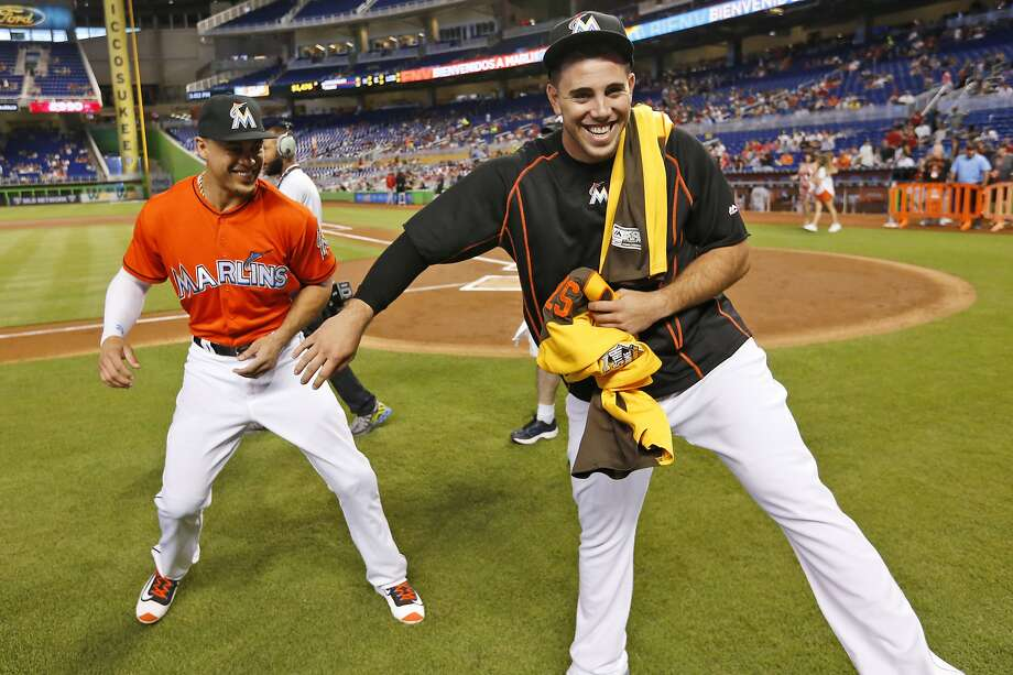Jose Fernandez, right, goofed with Marlins teammate Giancarlo Stanton whe nthey received their 2016 All-Star Game jerseys before the final game of the first half. Photo: Wilfredo Lee, Associated Press