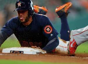 Houston Astros George Springer (4) is  doubled off of first base during the third inning of an MLB game at Minute Maid Park, Sunday, Sept. 25, 2016 in Houston.