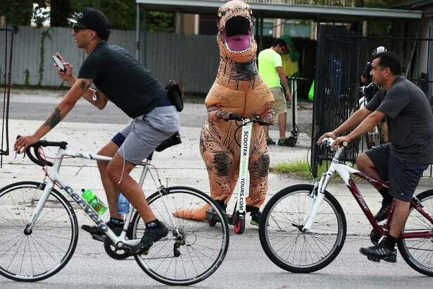 A T-Rex greets participants in Siclovia along Broadway Street, Sunday, Sept. 25, 2016. This year's Siclovia route stayed along Broadway from the intersection with McCullough on the south end to Mahncke Park in the north. The event ran between 10 a.m. and 3 p.m. and was closed to vehicular traffic during the duration.