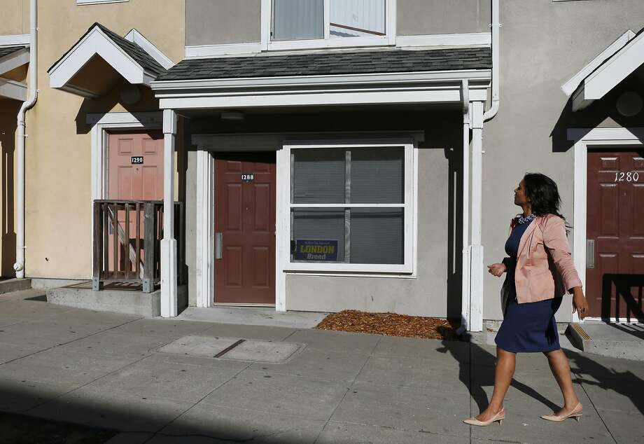 Supervisor London Breed walks past a housing complex similar to the one she grew up in during a tour with the San Francisco Chronicle in the Western Addition neighborhood, where Breed is from Sept. 21, 2016 San Francisco, Calif. Photo: Leah Millis, The Chronicle
