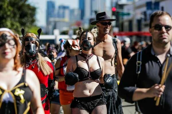 People dressed in costume walk through the Folsom Street Fair in San Francisco, California, on Sunday, Sept. 25, 2016.