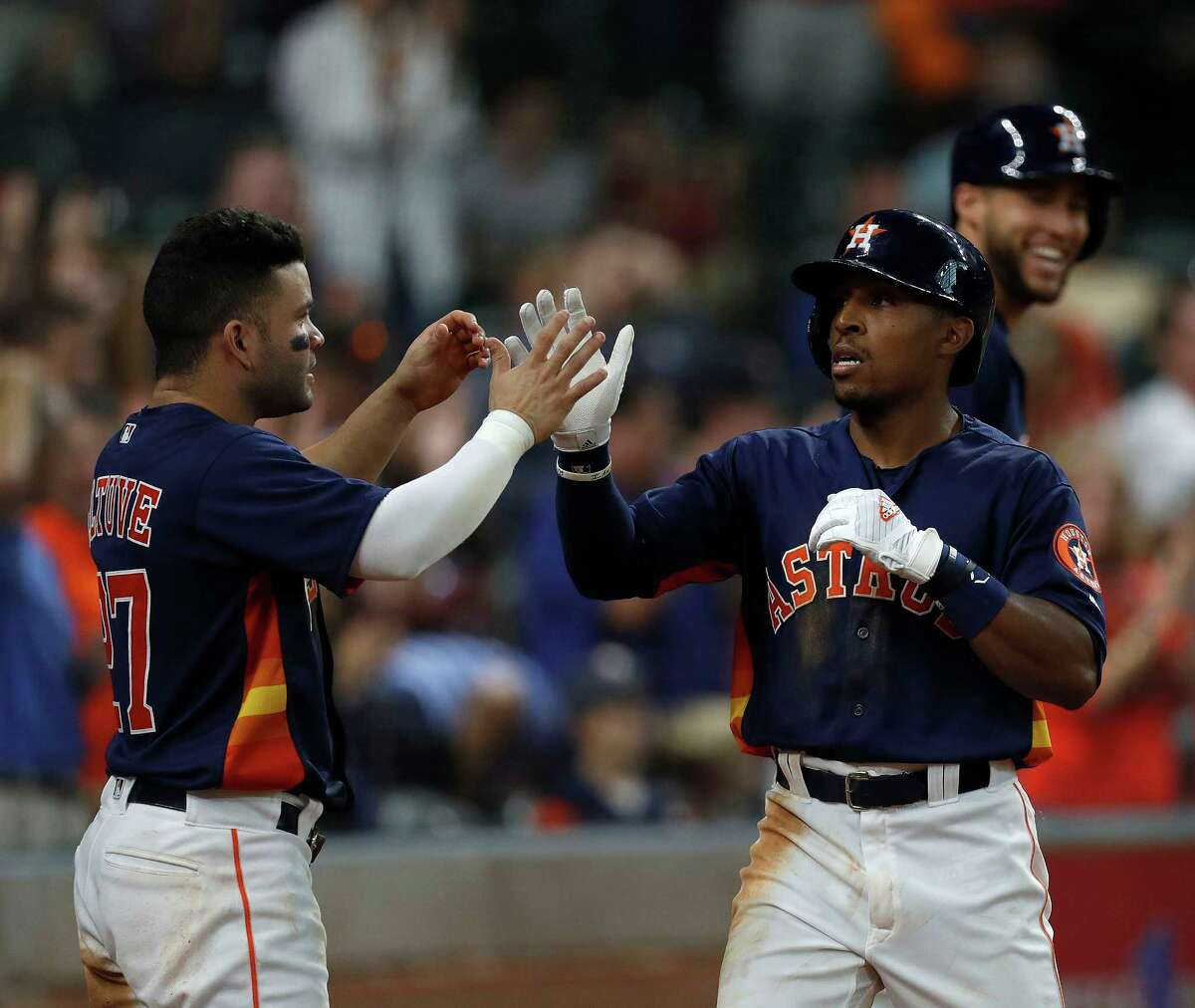 Houston Astros Tony Kemp (16) celebrates his first major league home run during the fifth inning with Jose Altuve (27) during an MLB game at Minute Maid Park, Sunday, Sept. 25, 2016 in Houston.