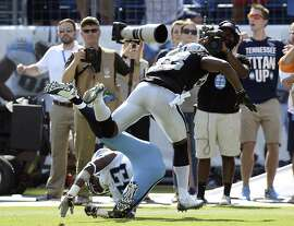 Tennessee Titans wide receiver Harry Douglas (83) falls and can't catch the pass as he is defended by Oakland Raiders strong safety T.J. Carrie (38) in the end zone on the Titans' last play of the fourth quarter in an NFL football game Sunday, Sept. 25, 2016, in Nashville, Tenn. The play gave control of the ball to the Raiders, who won 17-10. (AP Photo/Mark Zaleski)