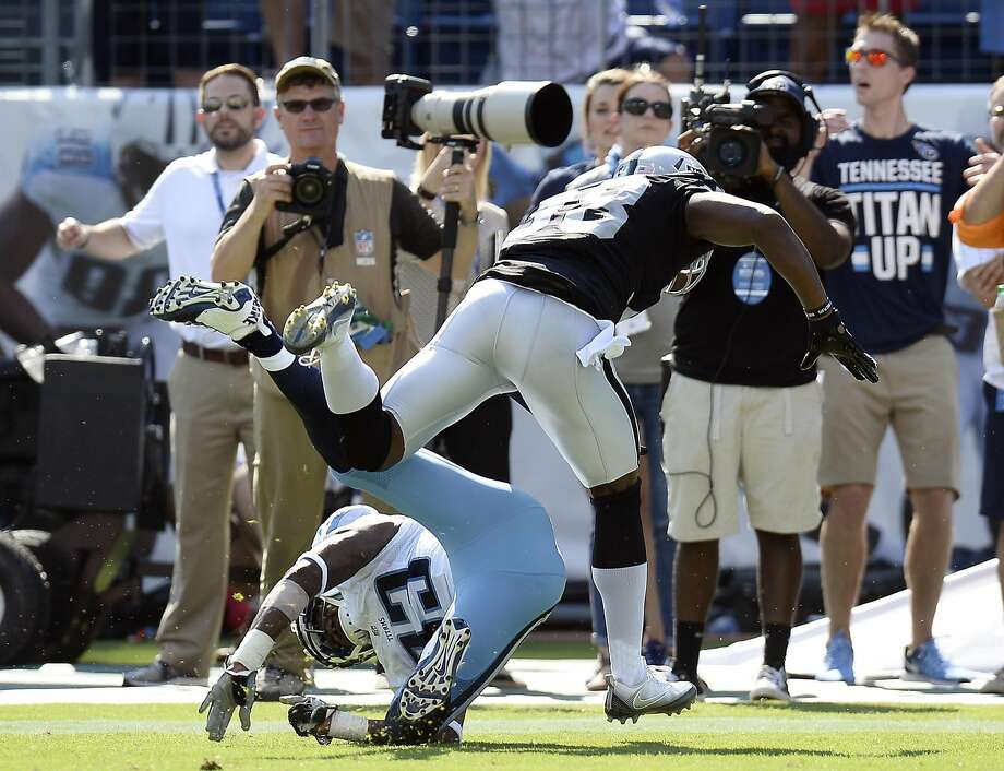 There was plenty of contact between the Raiders' TJ Carrie and Tennessee receiver Harry Douglas but no penalty was called on the fourth-down pass in the final minute of Sunday's game. Photo: Mark Zaleski, Associated Press