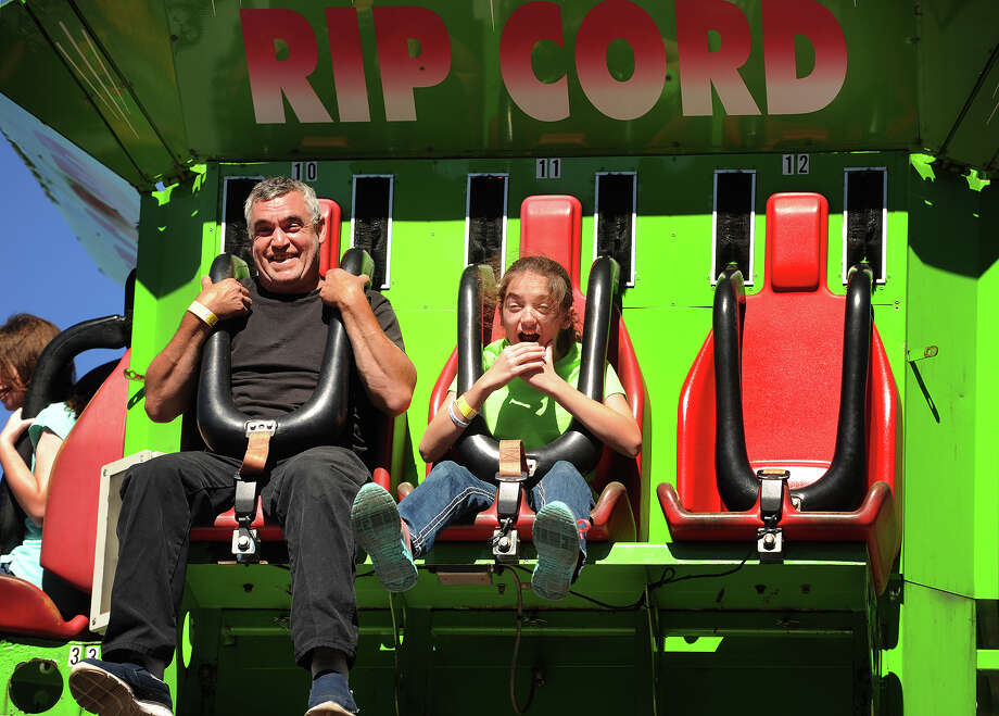 Michael Allegrini and daughter Jenna, 12, of Shelton, enjoy a carnival ride during day two of the annual R.D. Scinto Family Day Carnival for tenants, employees, and their families at the Scinto Complex on Corporate Drive in Shelton, Conn. on Sunday, September 25, 2016. Photo: Brian A. Pounds, Hearst Connecticut Media / Connecticut Post