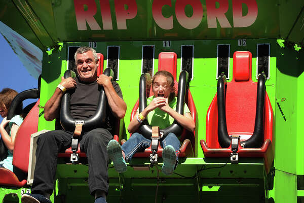 Michael Allegrini and daughter Jenna, 12, of Shelton, enjoy a carnival ride during day two of the annual R.D. Scinto Family Day Carnival for tenants, employees, and their families at the Scinto Complex on Corporate Drive in Shelton, Conn. on Sunday, September 25, 2016.