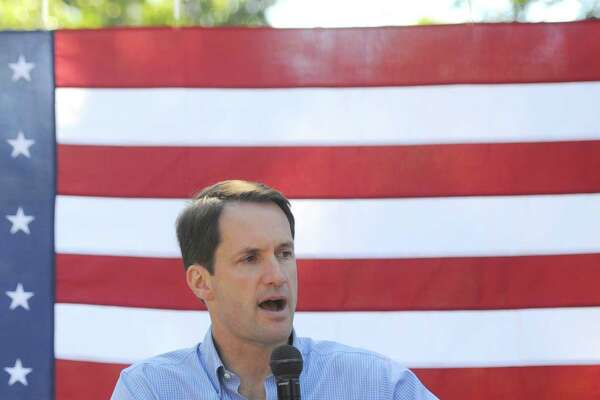 U.S. Rep. Jim Himes speaks at the Greenwich Democratic Town Committee annual picnic at the Garden Education Center in the Cos Cob section of Greenwich, Conn. Sunday, Sept. 25, 2016. Greenwich native U.S. Rep. Jim Himes joined State Senate candidate John Blankley and State House candidate Dita Bhargava and others to campaign to the Democratic party.