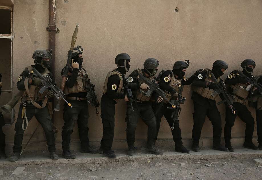 Soldiers from the 1st Battalion of the Iraqi Special Operations Forces take part in an exercise last month in Baghdad to prepare for the battle to retake Mosul. Photo: Maya Alleruzzo, Associated Press