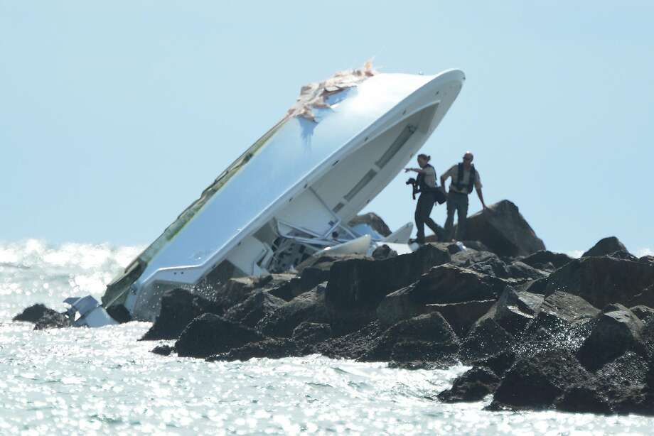 Investigators look over the overturned boat in which Miami Marlins pitcher Jose Fernandez was killed. Photo: JOE CAVARETTA, TNS
