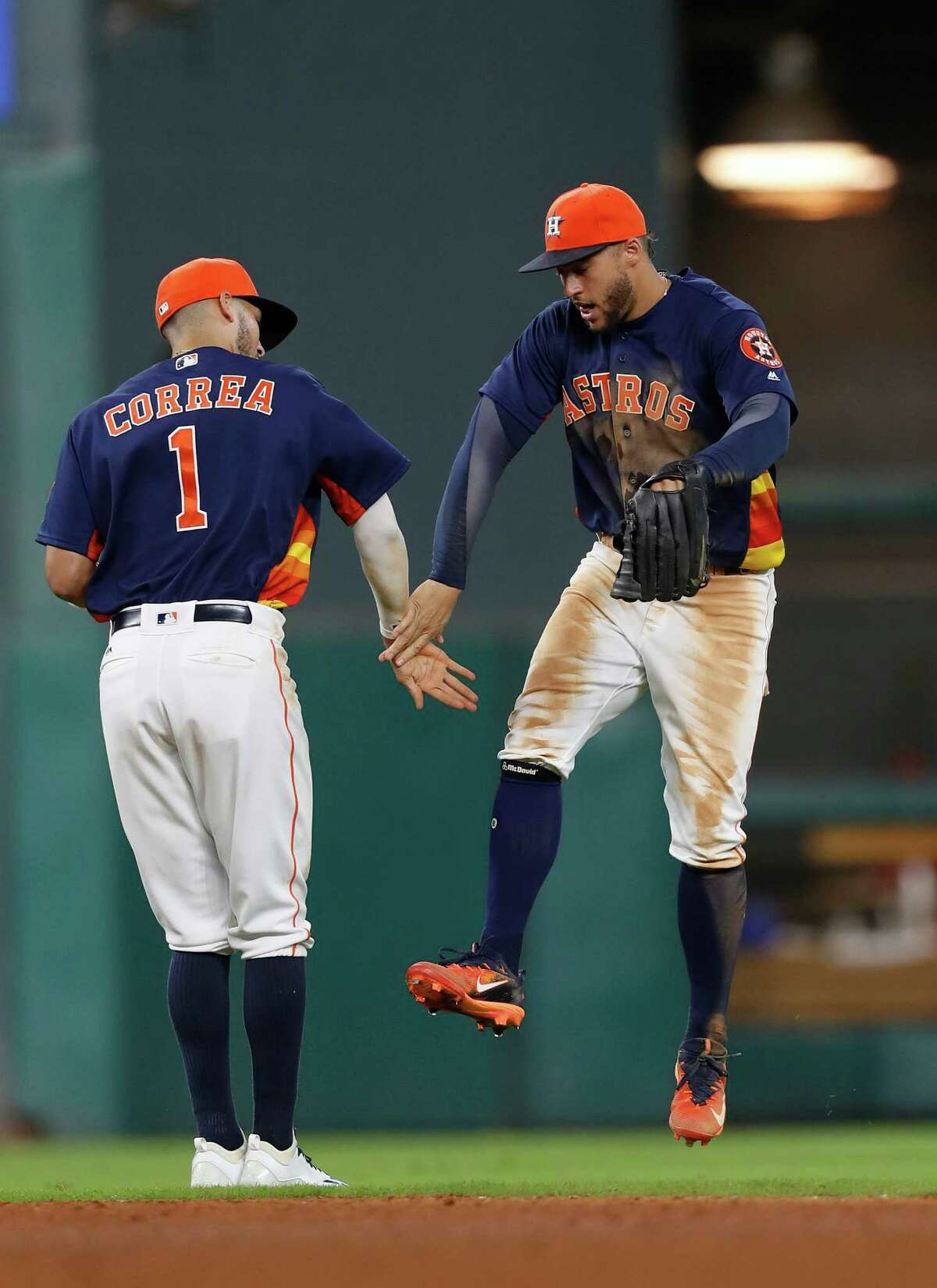 Houston Astros George Springer (4) and Carlos Correa (1) celebrate the Astros 4-1 win over Los Angeles Angels after an MLB game at Minute Maid Park, Sunday, Sept. 25, 2016 in Houston.