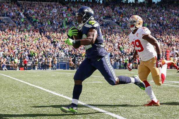 SEATTLE, WA - SEPTEMBER 25:  Running back Christine Michael #32 of the Seattle Seahawks rushes for a touchdown against safety Jaquiski Tartt #29 of the San Francisco 49ers at CenturyLink Field on September 25, 2016 in Seattle, Washington.  (Photo by Otto Greule Jr/Getty Images)