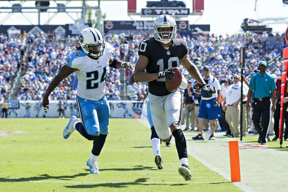 Oakland wide receiver Seth Roberts outruns Daimion Stafford of the Tennessee Titans to the end zone for a touchdown in the first half of the Raiders' 17-10 victory at Nissan Stadium. Photo: Wesley Hitt, Getty Images