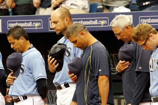 ST. PETERSBURG, FL - SEPTEMBER 25: Members of the  Tampa Bay Rays pause for a moment of silence for Miami Marlins pitcher Jose Fernandez prior to their game against the Boston Red Sox at Tropicana Field on September 25, 2016 in St. Petersburg, Florida. (Photo by Joseph Garnett Jr. /Getty Images)