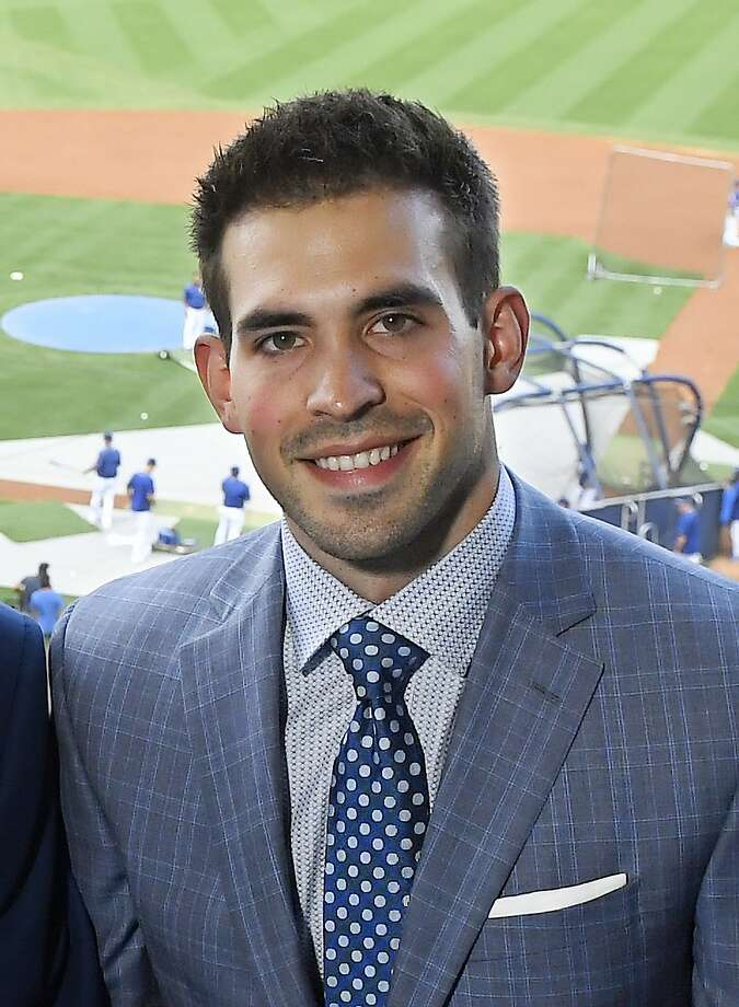 In this Tuesday, Sept. 20, 2016 photo Broadcaster Joe Davis poses prior to a baseball game between the Los Angeles Dodgers and the San Francisco Giants in Los Angeles. As Vin Scully closes out his Hall of Fame career calling Los Angeles Dodgers games, his successor is waiting in the wings. Joe Davis has been working road games for the team this season, warming up for next year when the 28-year-old will move into Scully's old booth full-time. (AP Photo/Mark J. Terrill) Photo: Mark J. Terrill, Associated Press
