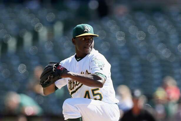 OAKLAND, CA - SEPTEMBER 25:  Jharel Cotton #45 of the Oakland Athletics pitches against the Texas Rangers in the first inning at Oakland-Alameda County Coliseum on September 25, 2016 in Oakland, California.  (Photo by Ezra Shaw/Getty Images)