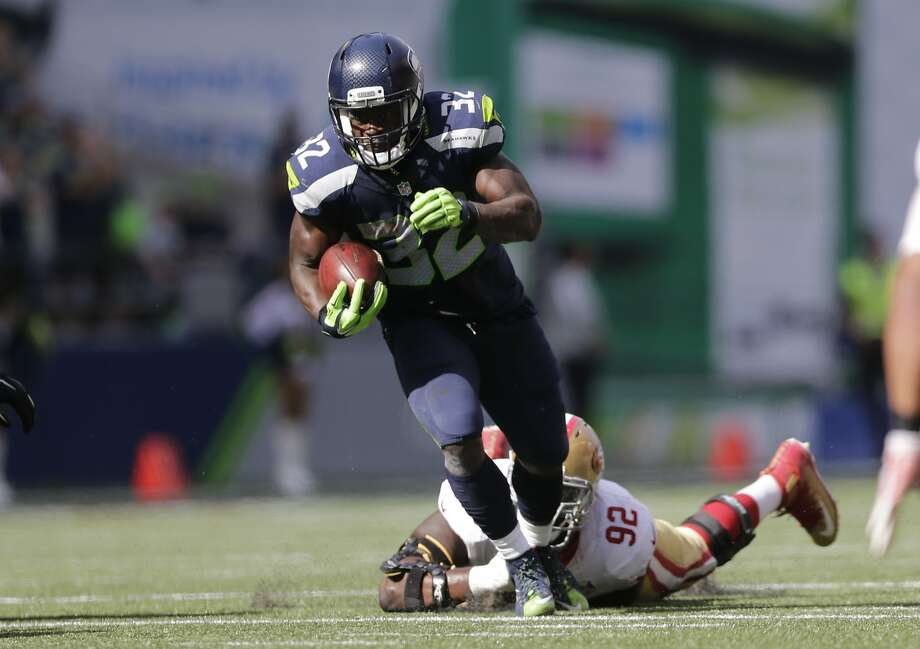 Seattle Seahawks' Christine Michael carries against the San Francisco 49ers in the first half of an NFL football game, Sunday, Sept. 25, 2016, in Seattle. (AP Photo/John Froschauer) Photo: John Froschauer, Associated Press