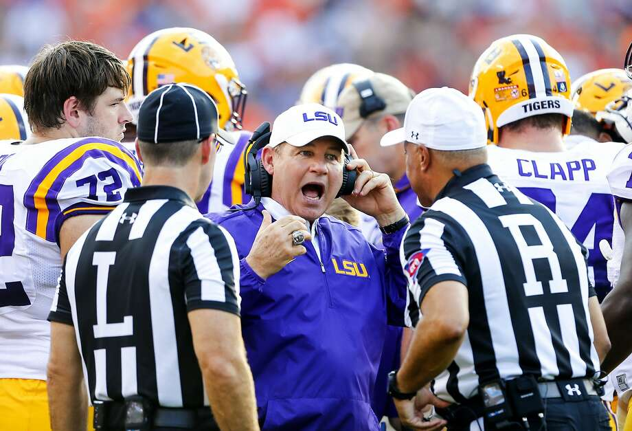 FILE - This Sept. 24, 2016 file photo shows LSU head coach Les Miles reacting to a call during the first half of an NCAA college football game against Auburn in Auburn, Ala. Two people familiar with the decision say LSU has fired Miles and offensive coordinator Cam Cameron and promoted defensive line coach Ed Orgeron to interim head coach. The person spoke to The Associated Press on Sunday, Sept. 25, 2016 on condition of anonymity because no announcement has been made. Miles firing comes one day after LSU lost 18-13 at Auburn. (AP Photo/Butch Dill, file) Photo: Butch Dill, Associated Press