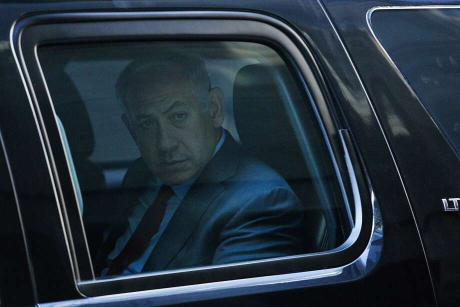 Israeli Prime Minister Benjamin Netanyahu leaves in his vehicle after a meeting with Republican presidential candidate Donald Trump at Trump Tower, Sunday, Sept. 25, 2016, in New York. (AP Photo/ Evan Vucci) Photo: Evan Vucci, Associated Press
