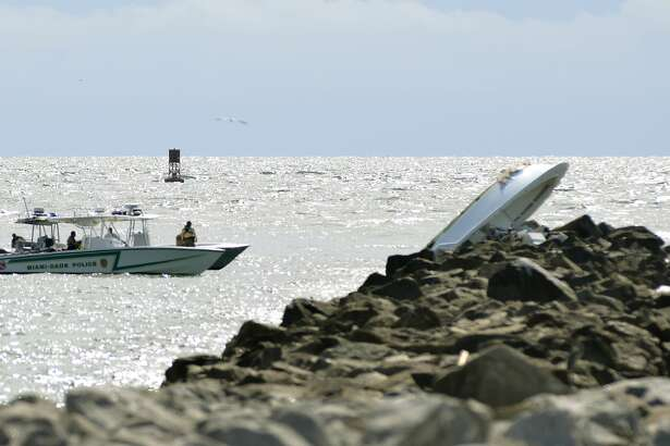 Investigators appear at the scene of a boat accident, Sunday, Sept. 25, 2016, off Miami Beach, Fla. Authorities said that Miami Marlins starting pitcher Jose Fernandez was one of three people killed in the boat crash early Sunday morning. He was 24. (AP Photo/Gaston De Cardenas)