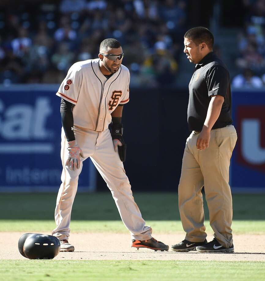 SAN DIEGO, CALIFORNIA - SEPTEMBER 25:  Eduardo Nunez #10, left, talks with a trainer after a play during the seventh inning of a baseball game against the San Diego Padres at PETCO Park on September 25, 2016 in San Diego, California.  (Photo by Denis Poroy/Getty Images) Photo: Denis Poroy, Getty Images