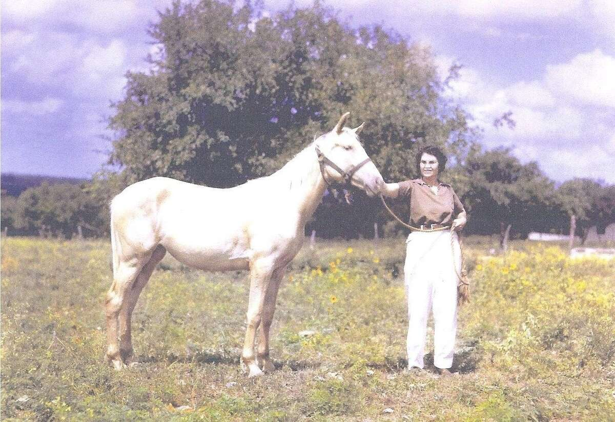 Frances Kallison with a horse in a 1940s photo.