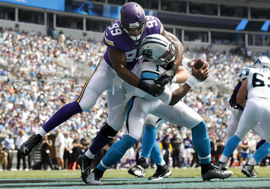 Minnesota's Danielle Hunters sacks Cam Newton in the end zone for a safety in the first quarter. Photo: Carlos Gonzalez, Associated Press