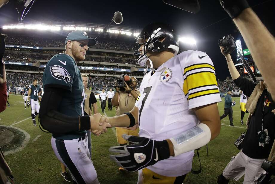 Eagles rookie Carson Wentz (left) outplayed Steelers QB Ben Roethlisberger, merely a two-time Super Bowl champ. Photo: Michael Perez, Associated Press