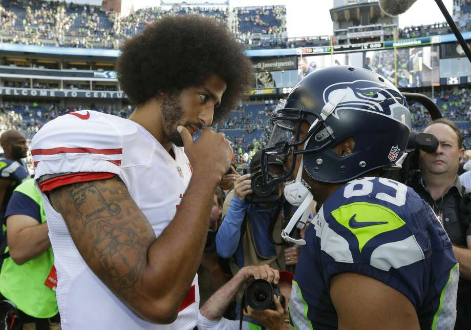 San Francisco 49ers quarterback Colin Kaepernick, left, talks with Seattle Seahawks wide receiver Doug Baldwin, right, following an NFL football game, Sunday, Sept. 25, 2016, in Seattle. The Seahawks defeated the 49ers 37-18. (AP Photo/Ted S. Warren) Photo: Ted S. Warren/AP