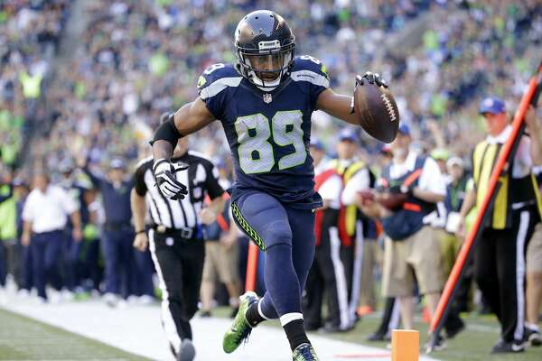 Seattle Seahawks' Doug Baldwin scores a touchdown against the San Francisco 49ers in the second half of an NFL football game, Sunday, Sept. 25, 2016, in Seattle. (AP Photo/Ted S. Warren)