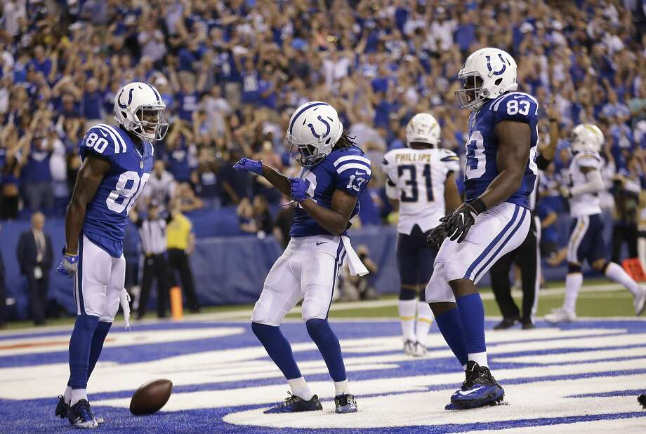 Indianapolis' T.Y. Hilton (13) shimmies after scoring on a 63-yard reception during from Andrew Luck late in the fourth quarter. Photo: AJ Mast, Associated Press