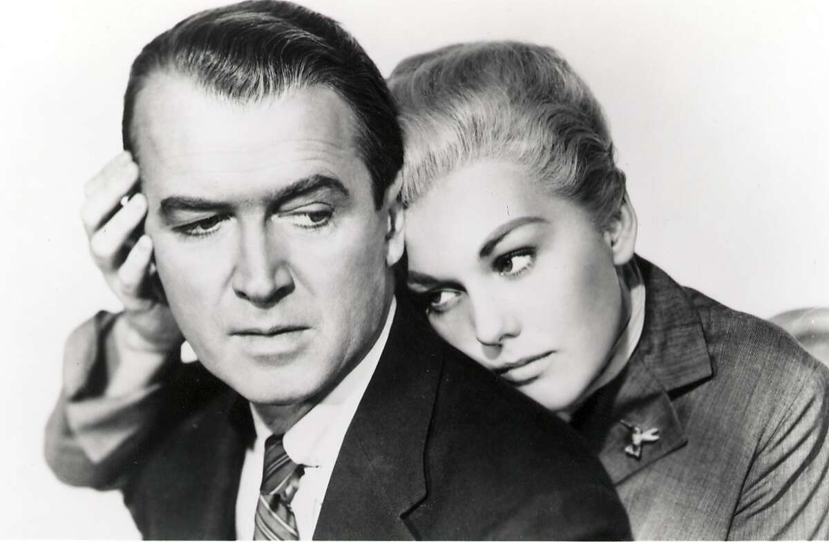 """James Stewart and Kim Novak in Hitchcock's classic 'Vertigo.' James Stewart is John """"Scottie"""" Ferguson, a former police detective with an acute fear of heights who is hired by an old college pal to trail his mysterious wife (Kim Novak). (1997)"""