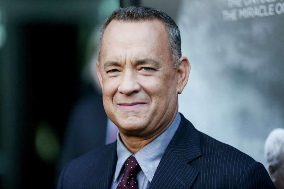 """FILE - In this Sept. 8, 2016 file photo, Tom Hanks arrives at the premiere of """"Sully"""" in Los Angeles. Hanks is returning to Cleveland on December 2, to headline the Greater Cleveland Film Commission's annual fundraiser, """"Behind the Camera."""" Hanks started his professional acting career in Cleveland as an intern at the Great Lakes Shakespeare Festival.  (Photo by Rich Fury/Invision/AP, File) ORG XMIT: NYET701 Photo: Rich Fury / Invision"""